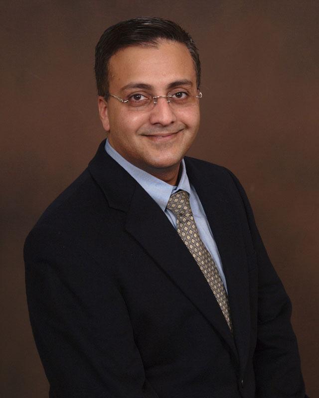 Dr. Karan Madan